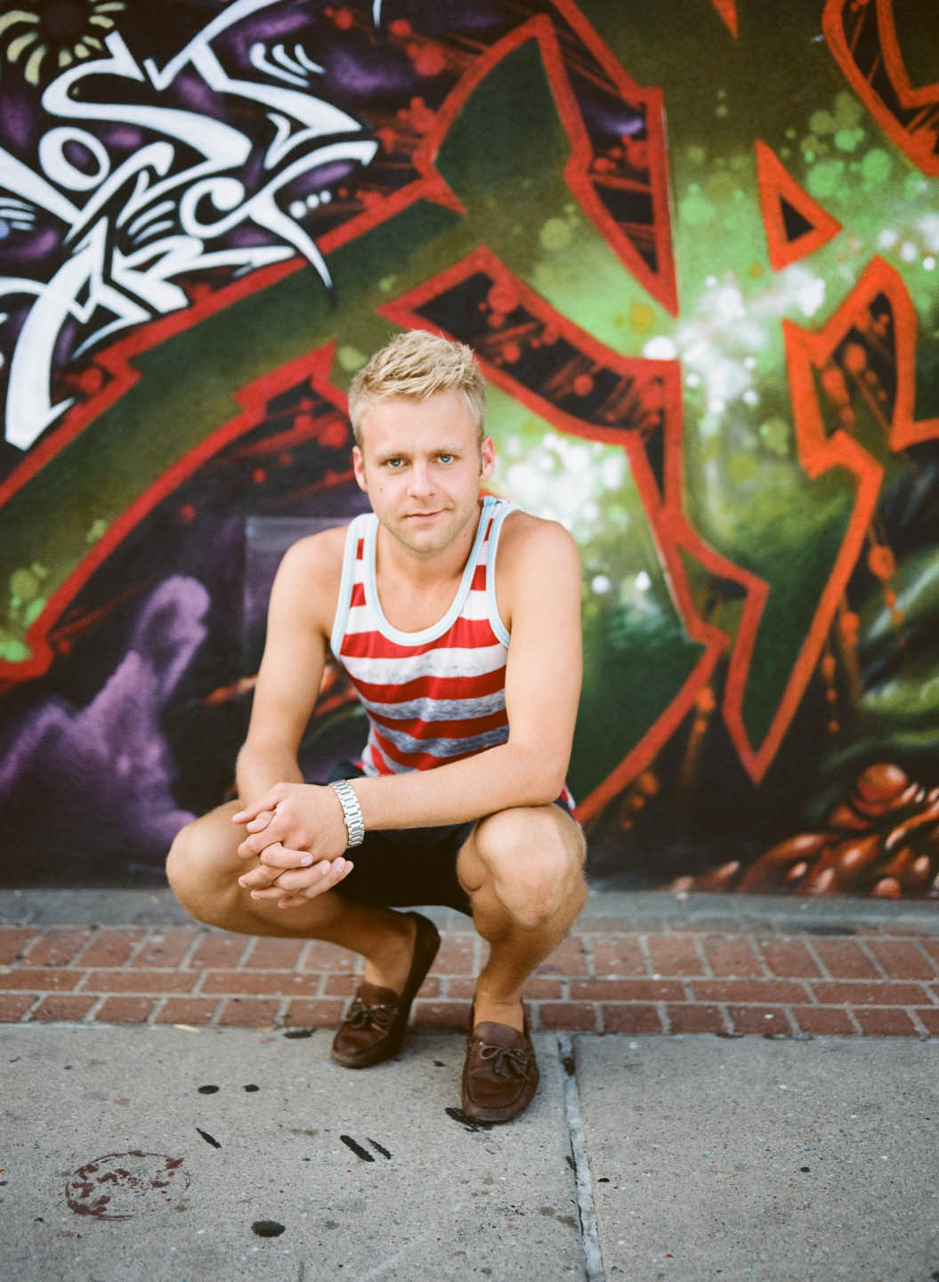 Male portrait with graffiti background