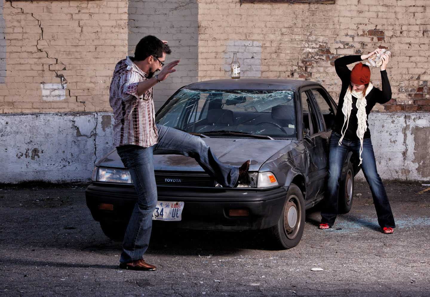 Anne and Aaron destroy and abandoned car