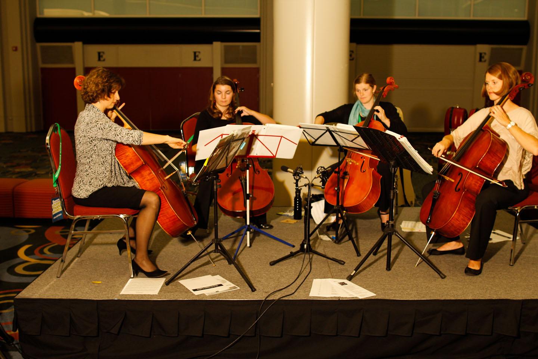 A cello quartet plays