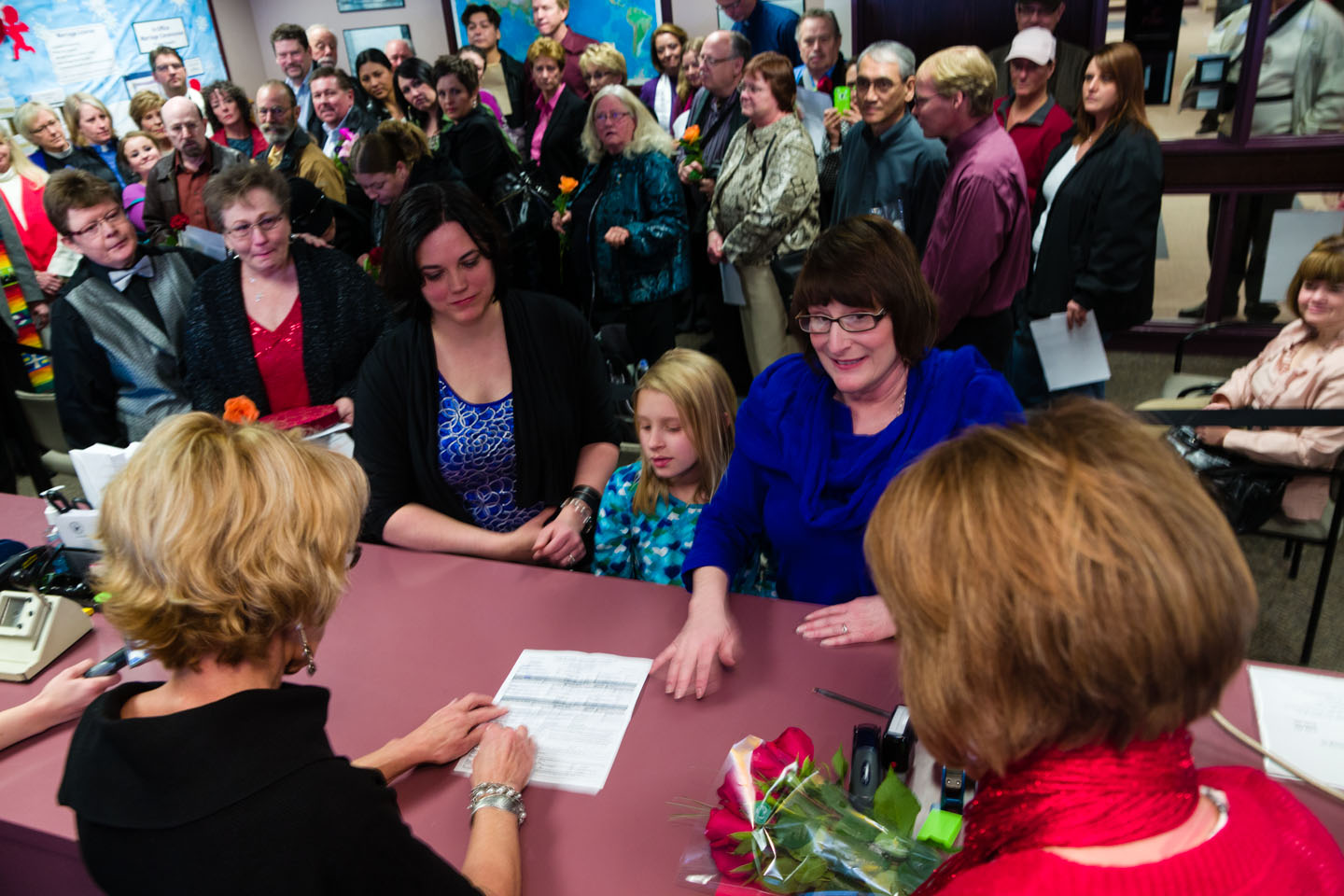 A family with same sex parents apply for a marriage license
