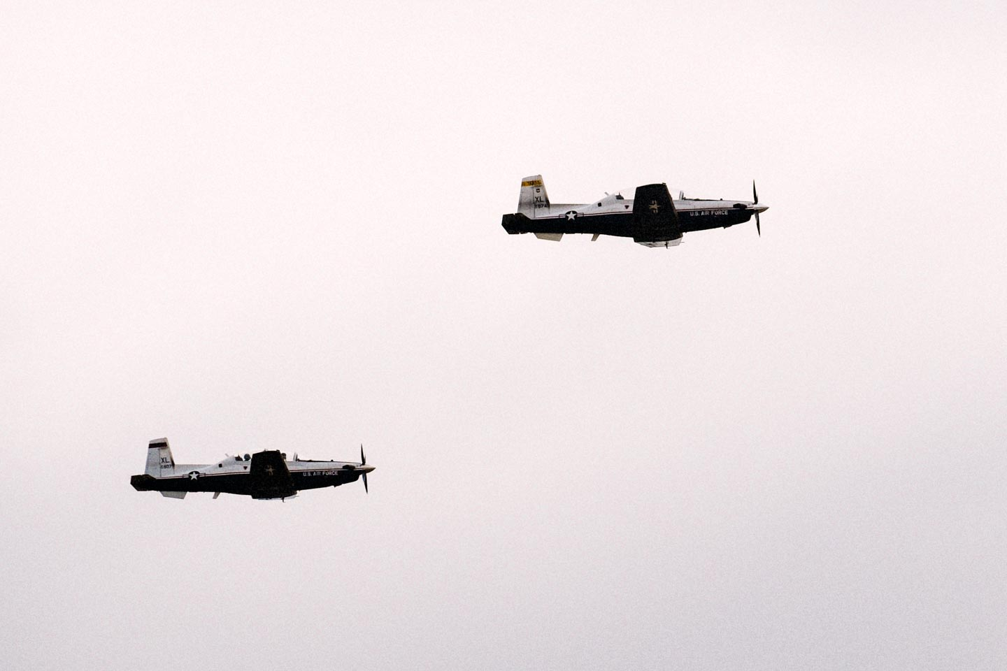 A pair of T-6 planes fly in formation