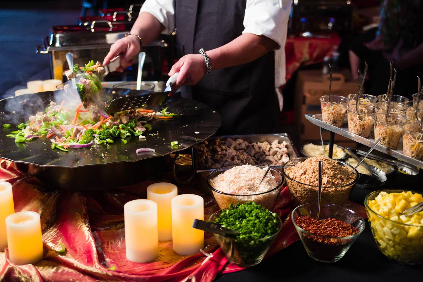 Making fresh chinese food by Le Croissant Catering
