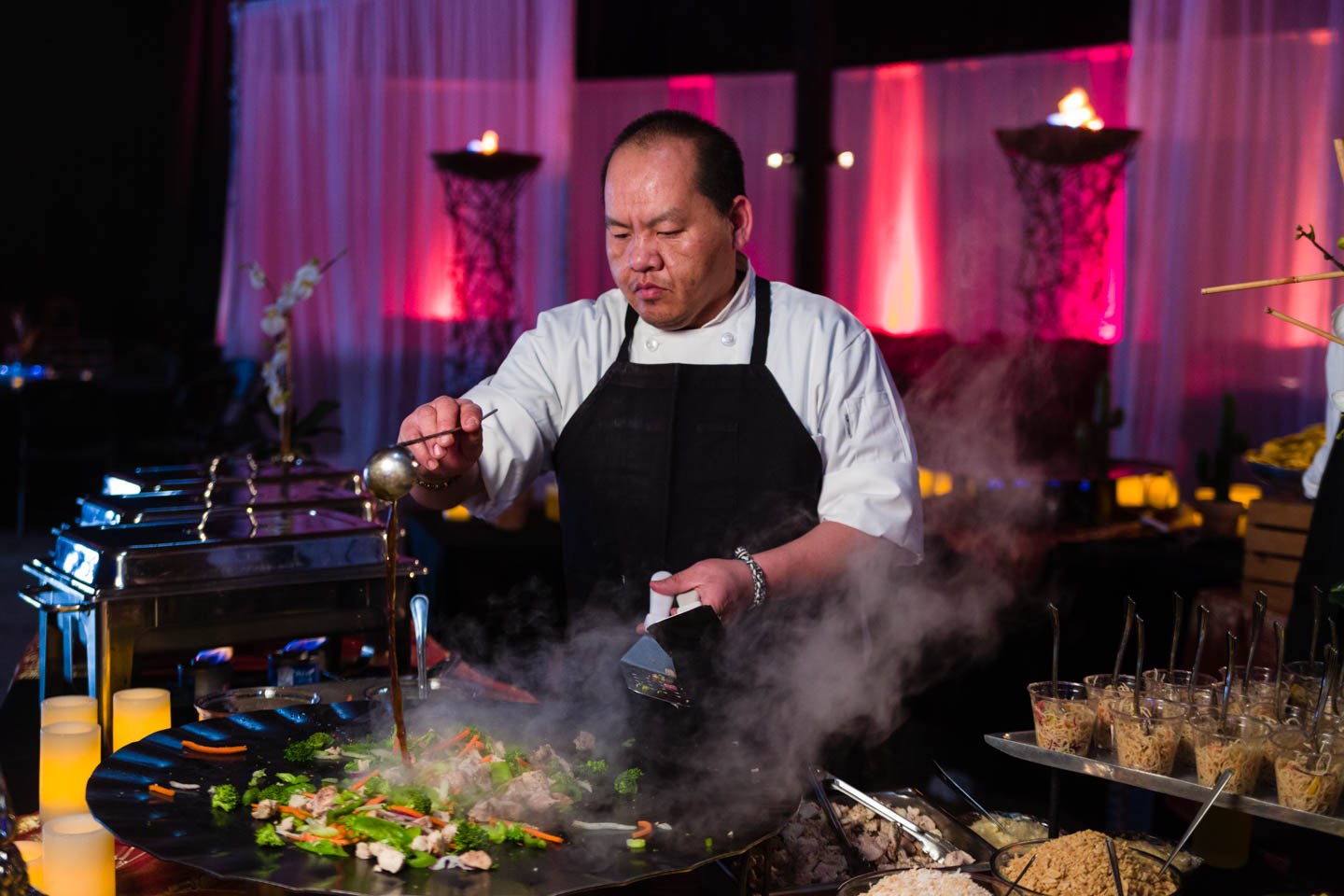 Chef creates stir fry for the party at The Complex