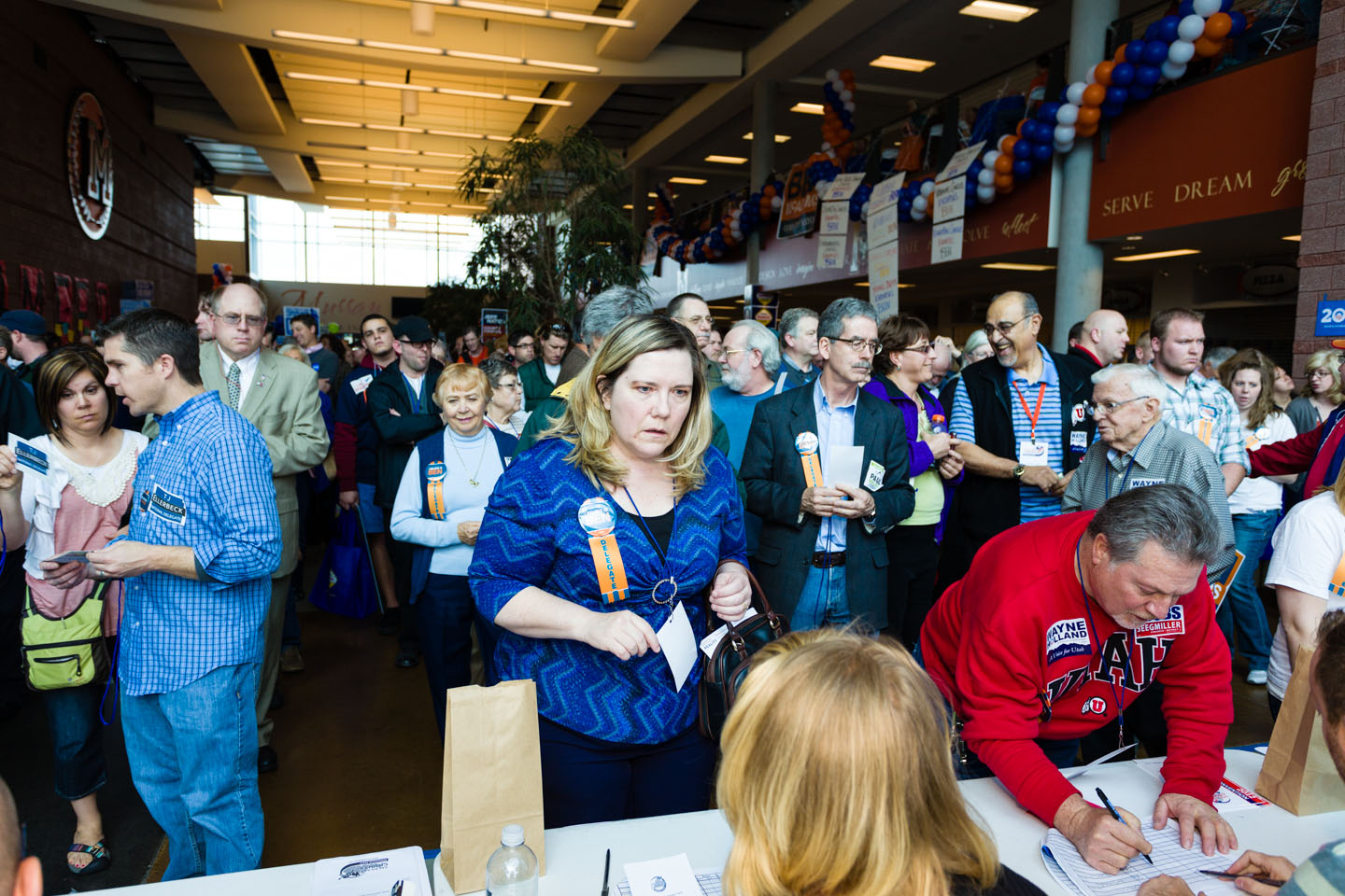 Conventioneers line up to cast their ballots for Salt Lake County Mayor