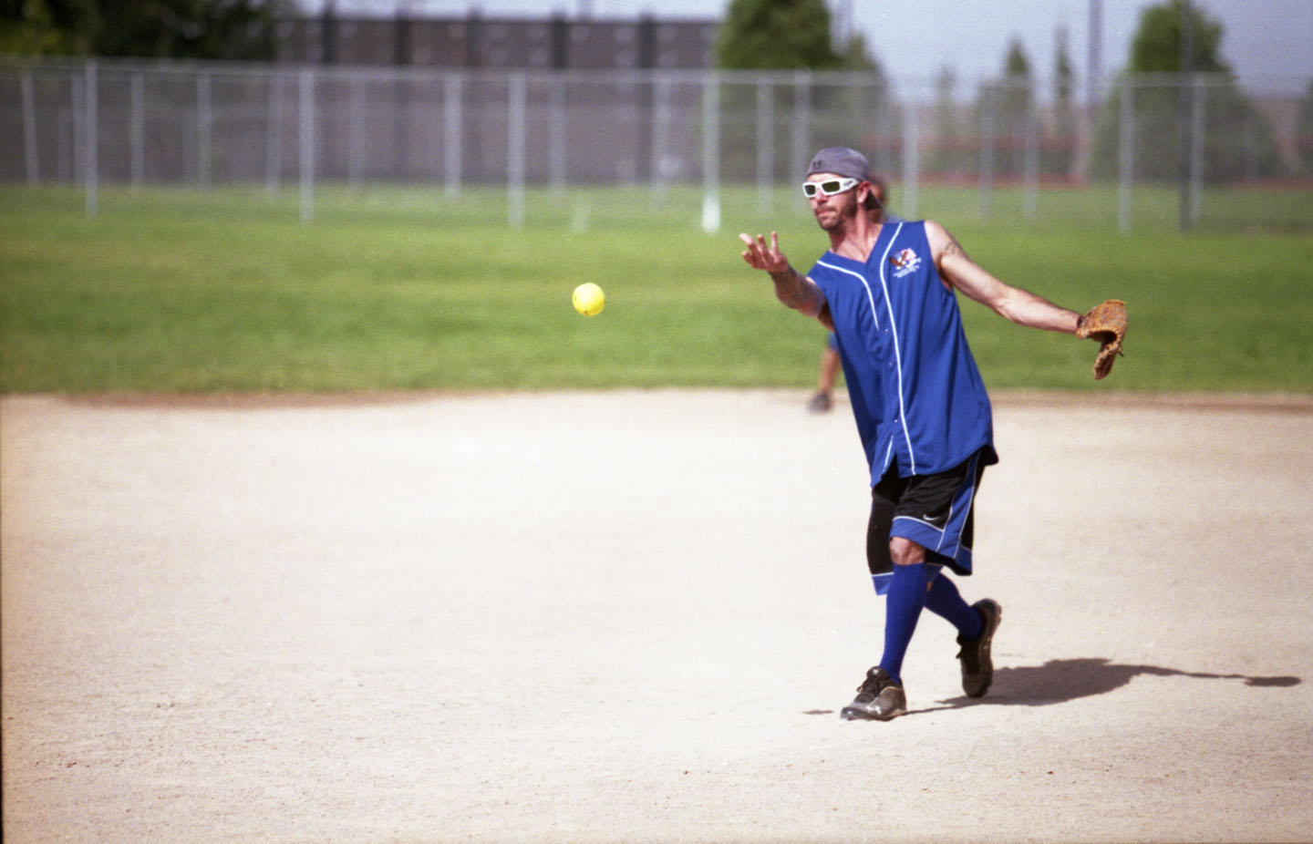 Blue pitcher throws the ball
