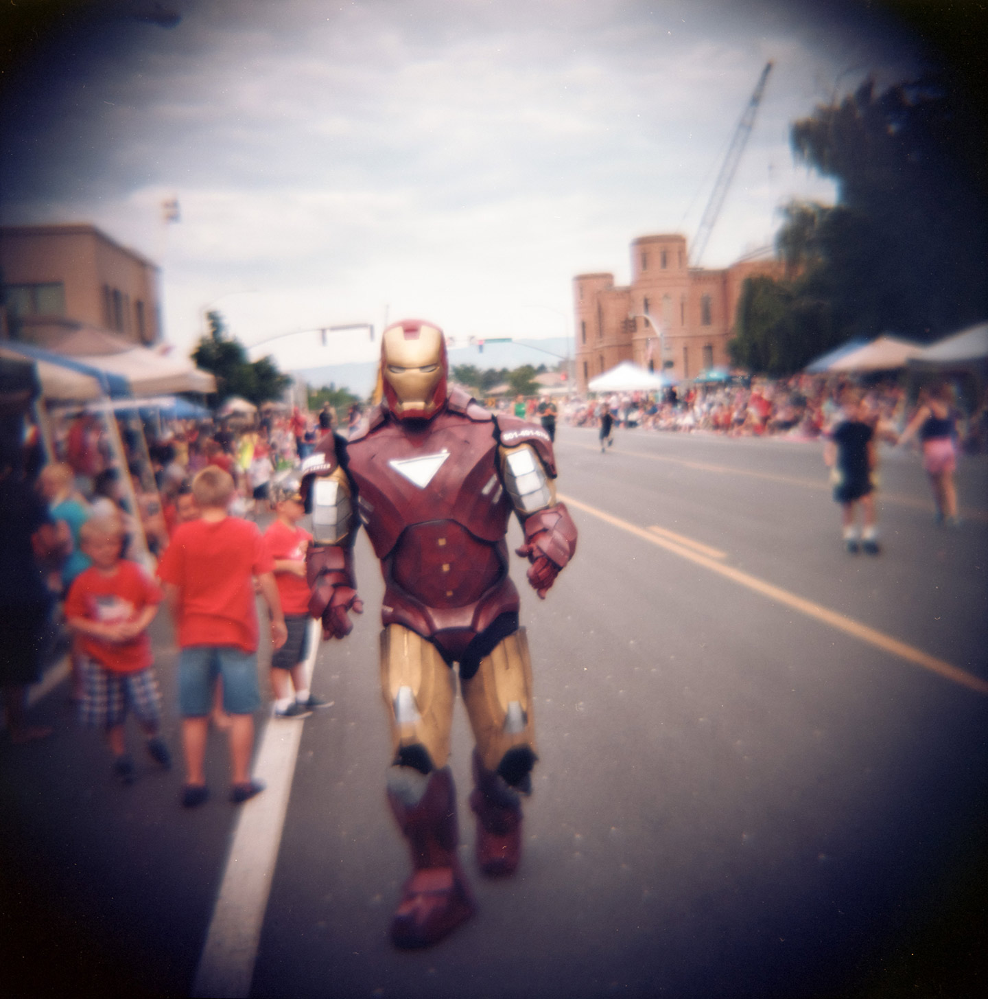 Iron Man walks in the Freedom Festival Parade