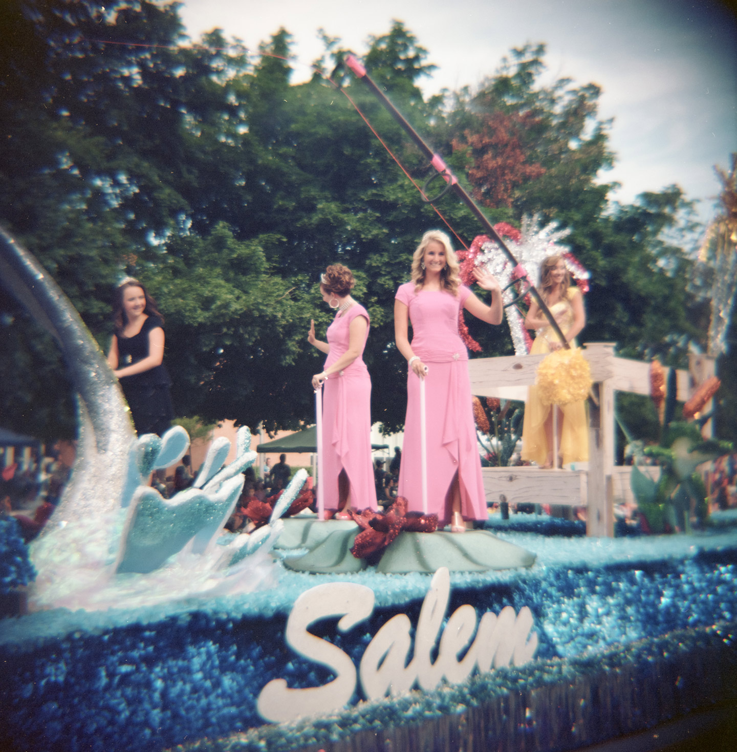Beauty contestants from Salem Utah ride their float in the parade