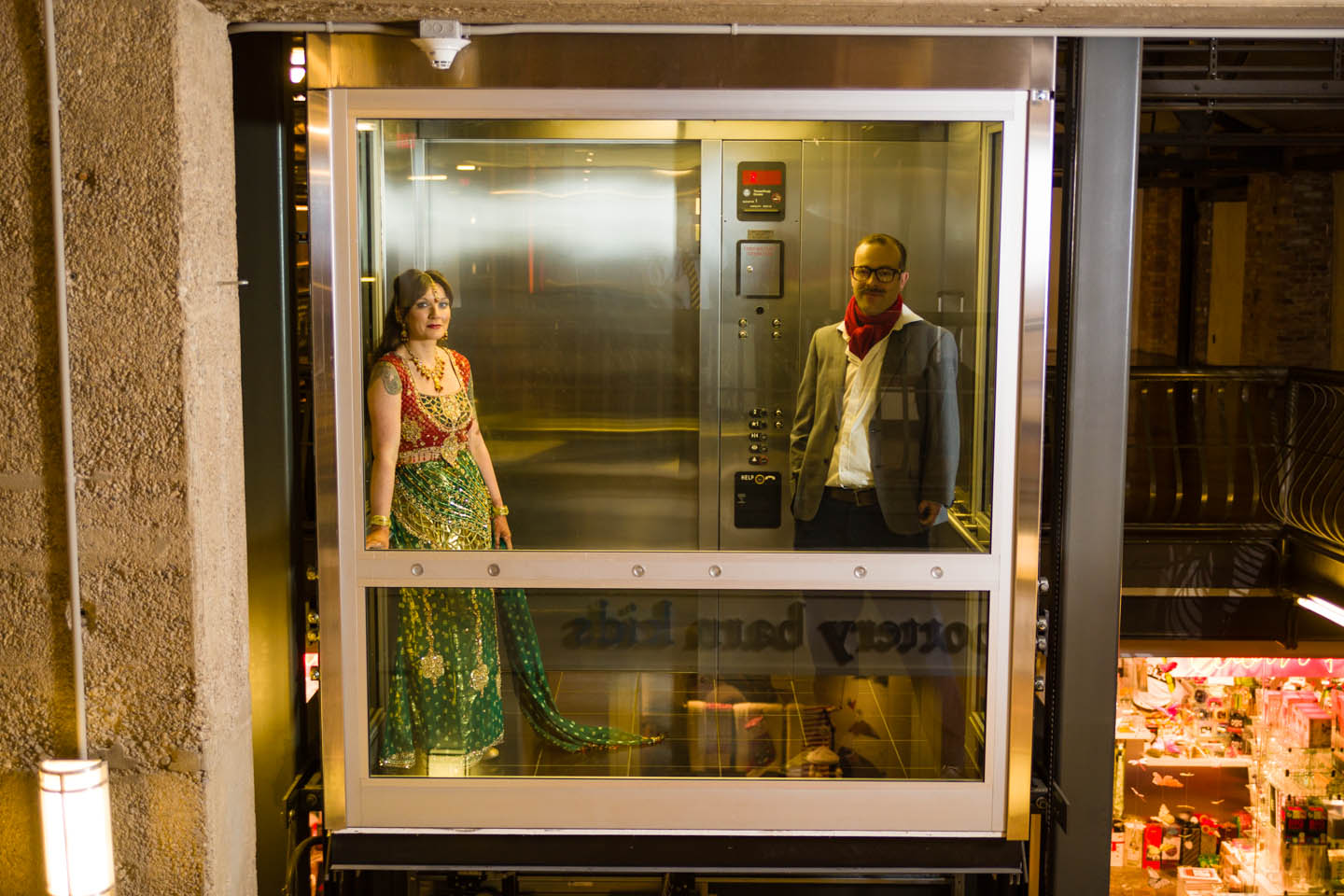 Creating the formal wedding photos in an elevator