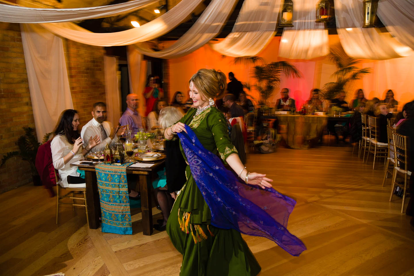 A belly dancer entertains the wedding party