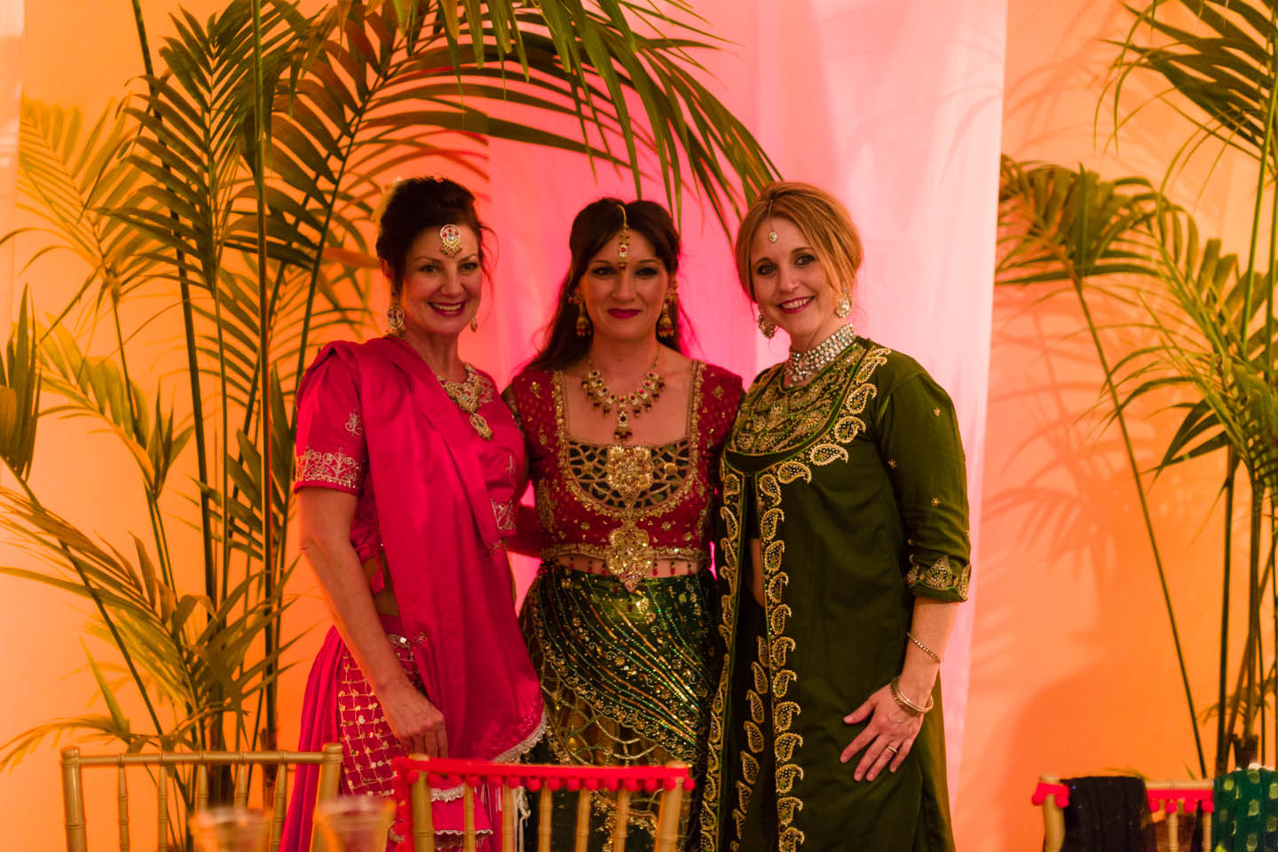 Bride with others wearing the traditional Indian wear
