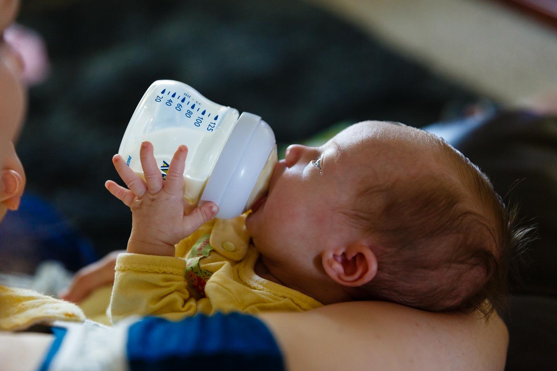 Baby Molly enjoys a bottle