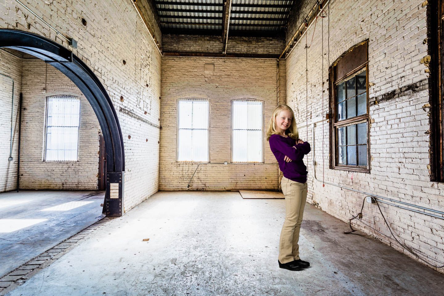 Just to practice adding feet to a photo we have Julianne in a warehouse