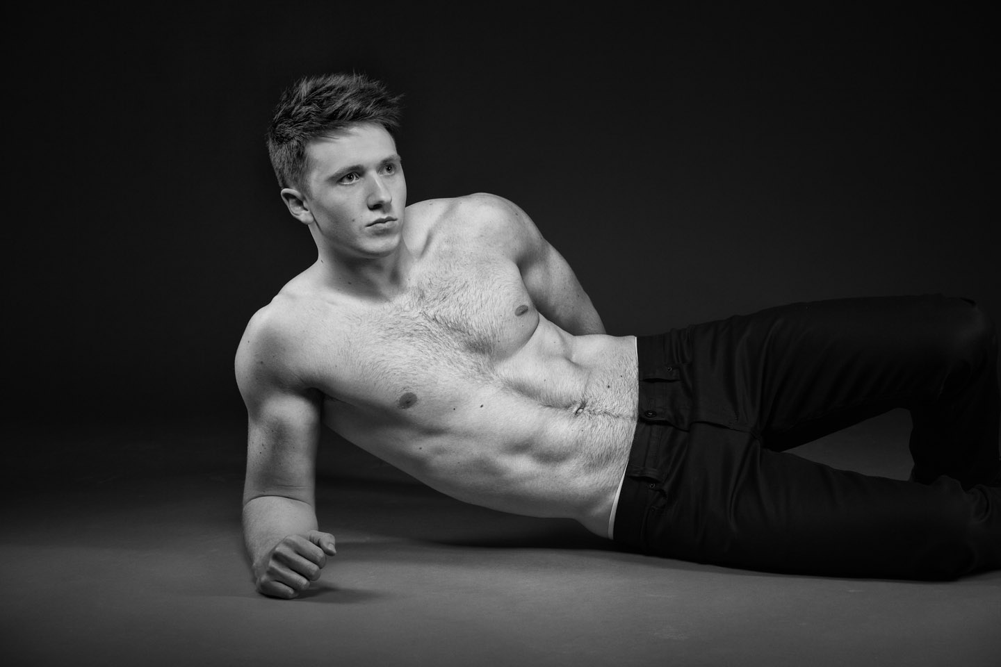 Trying some reclined poses for the shirtless male model