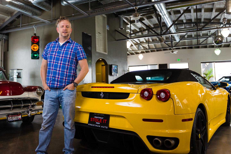 dav.d stands by a Ferrari at Prestman auto
