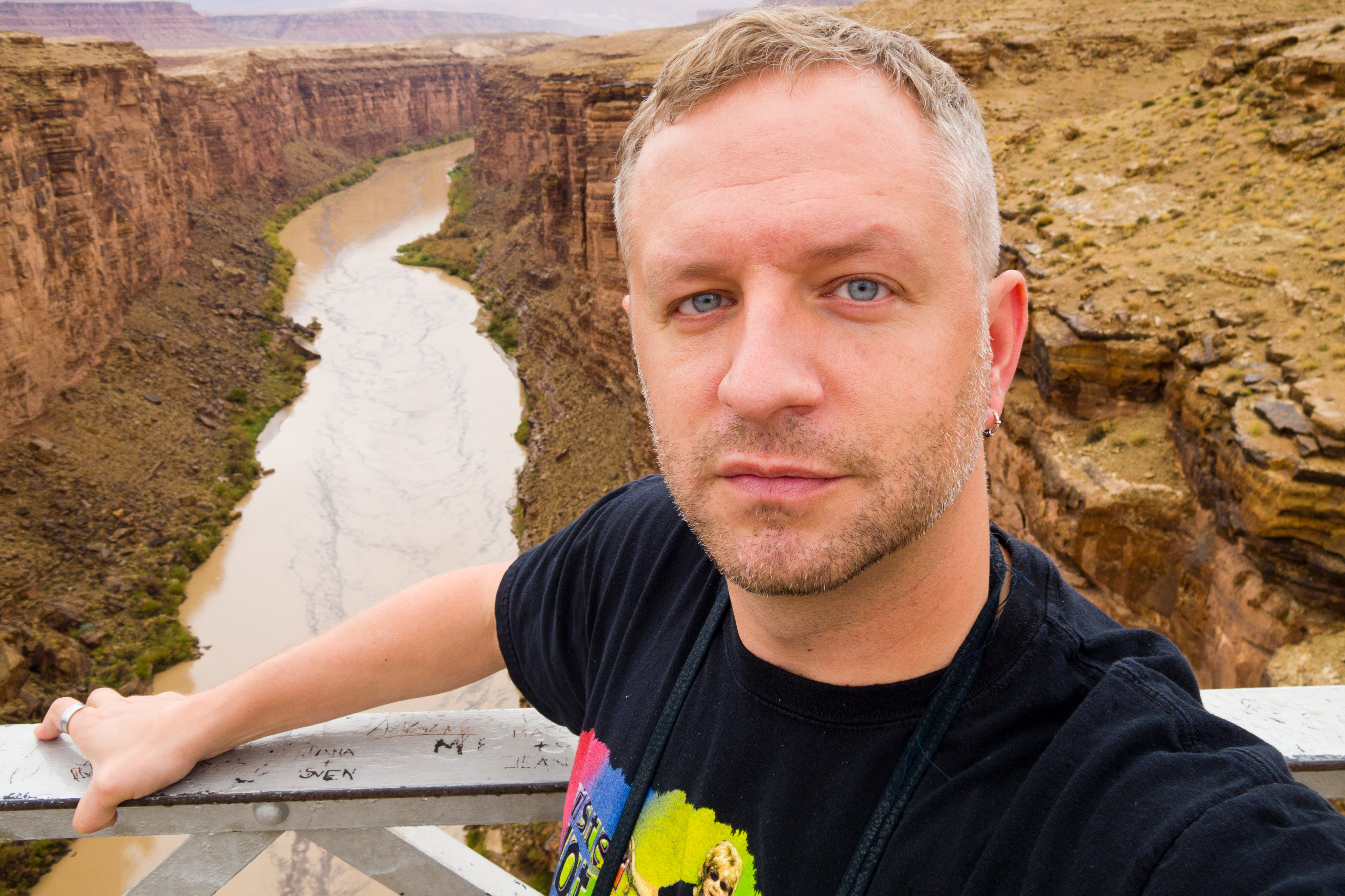dav.d stands over the Colorado River in Arizona. Let me take a selfie!