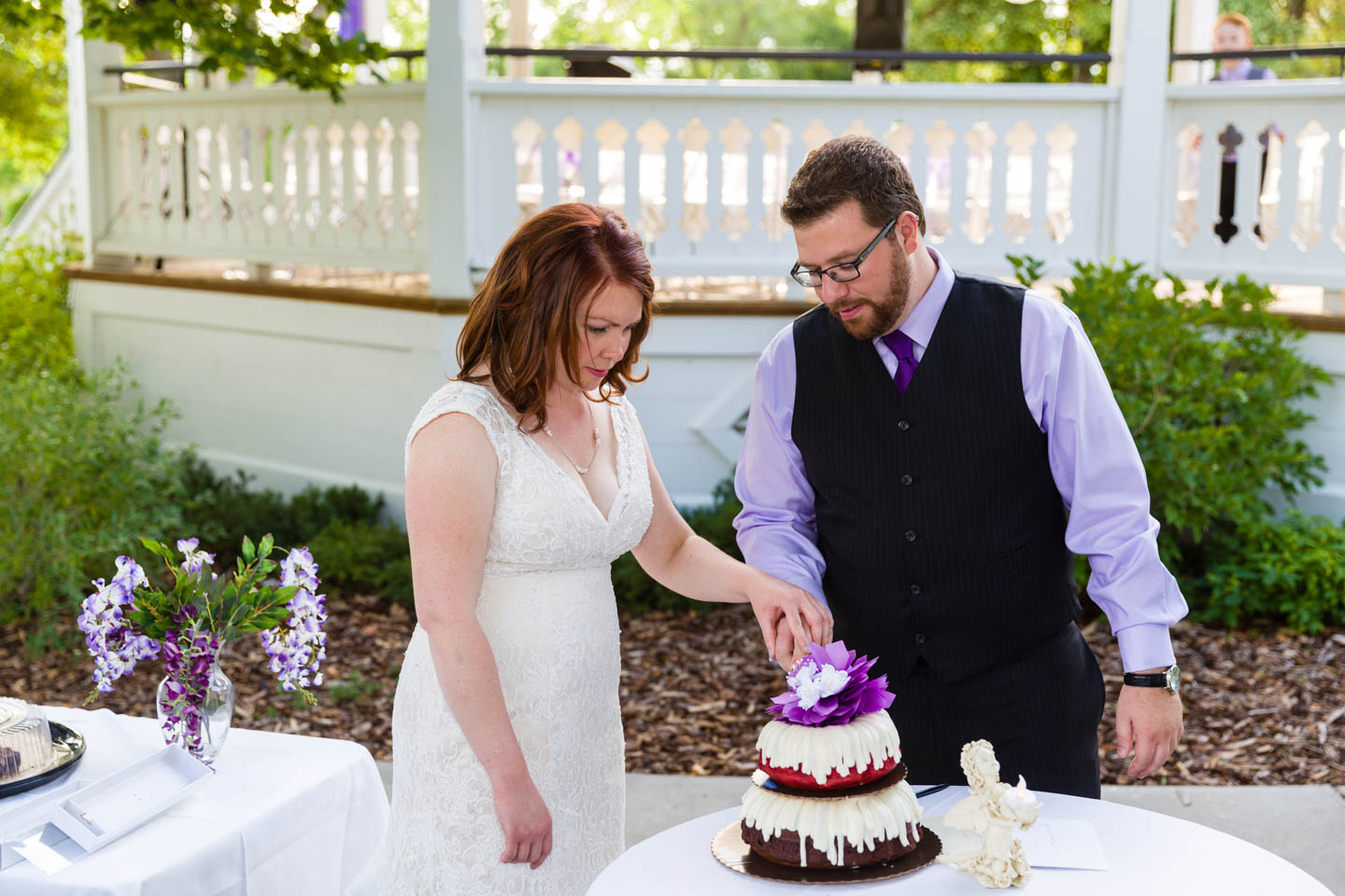 Cutting the wedding cake. It was red velvet.