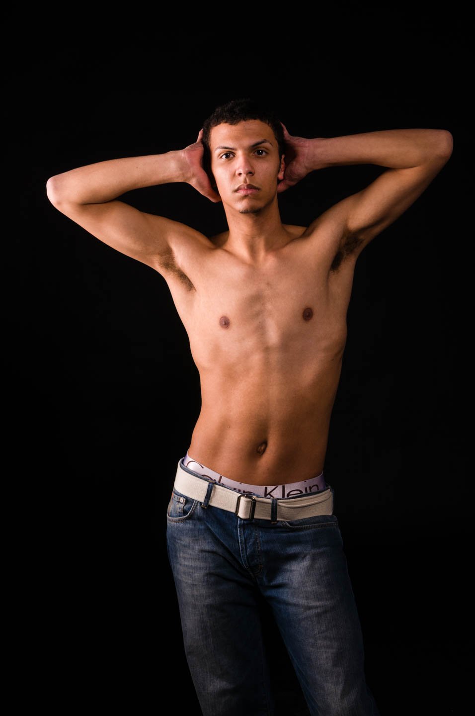 Bradley's fitness photo as he is shirtless on a black background in studio