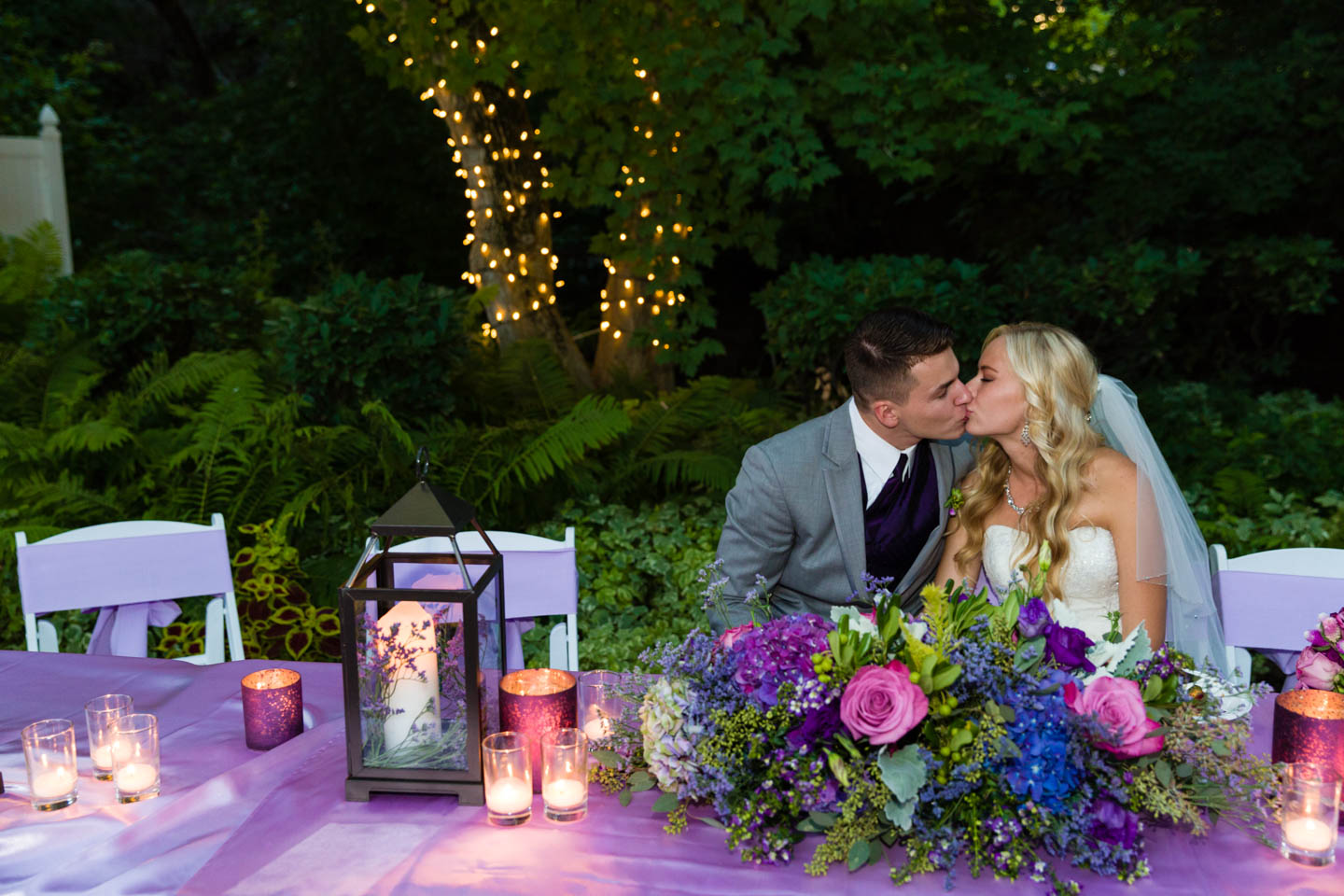 Bride and groom share a kiss during a quiet moment during the reception
