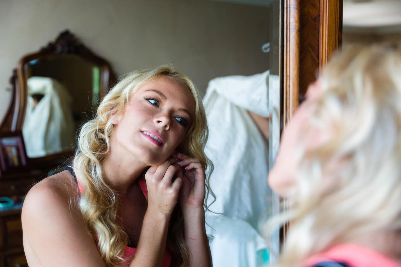 Bride puts on her earrings