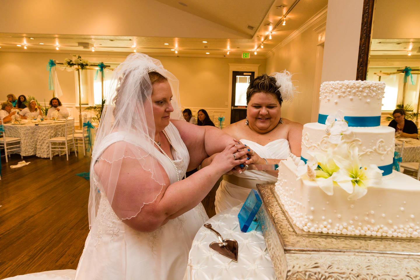 Brides cut the wedding cake