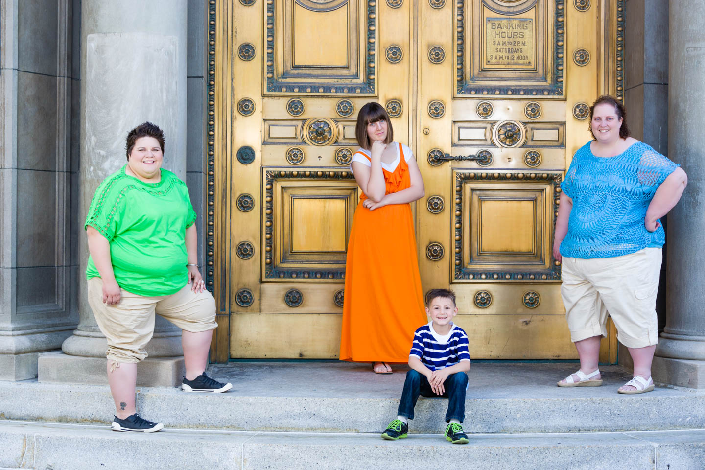 Family engagement photos by the Golden Doors in Exchange Place