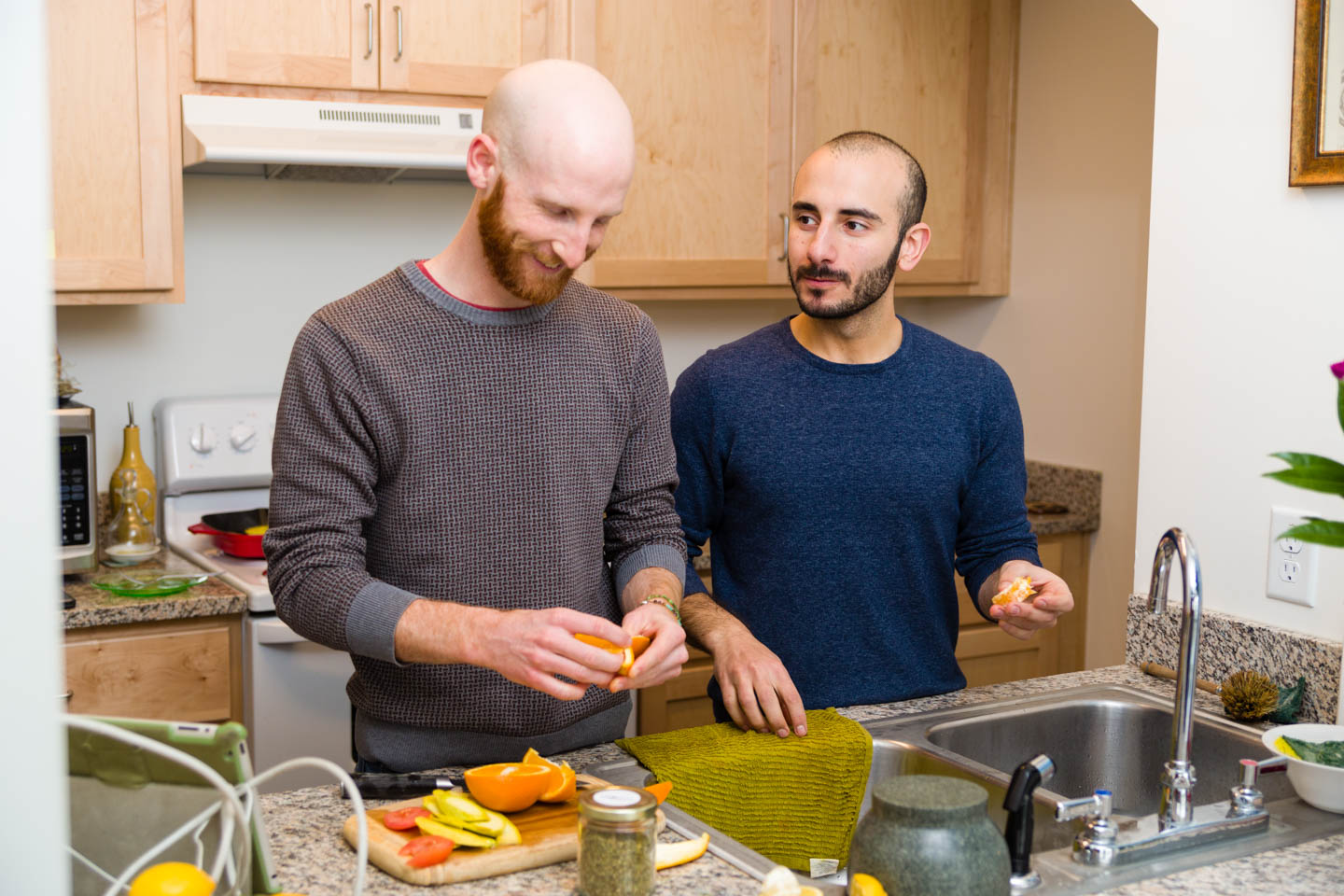 Derek Kitchen and Moudi Sbeity prepare lunch at home