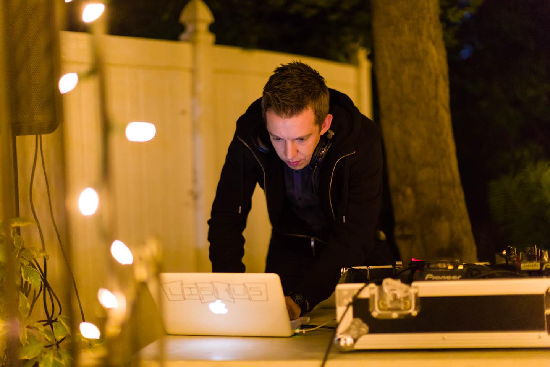 DJ Lishus plays the music for the wedding reception