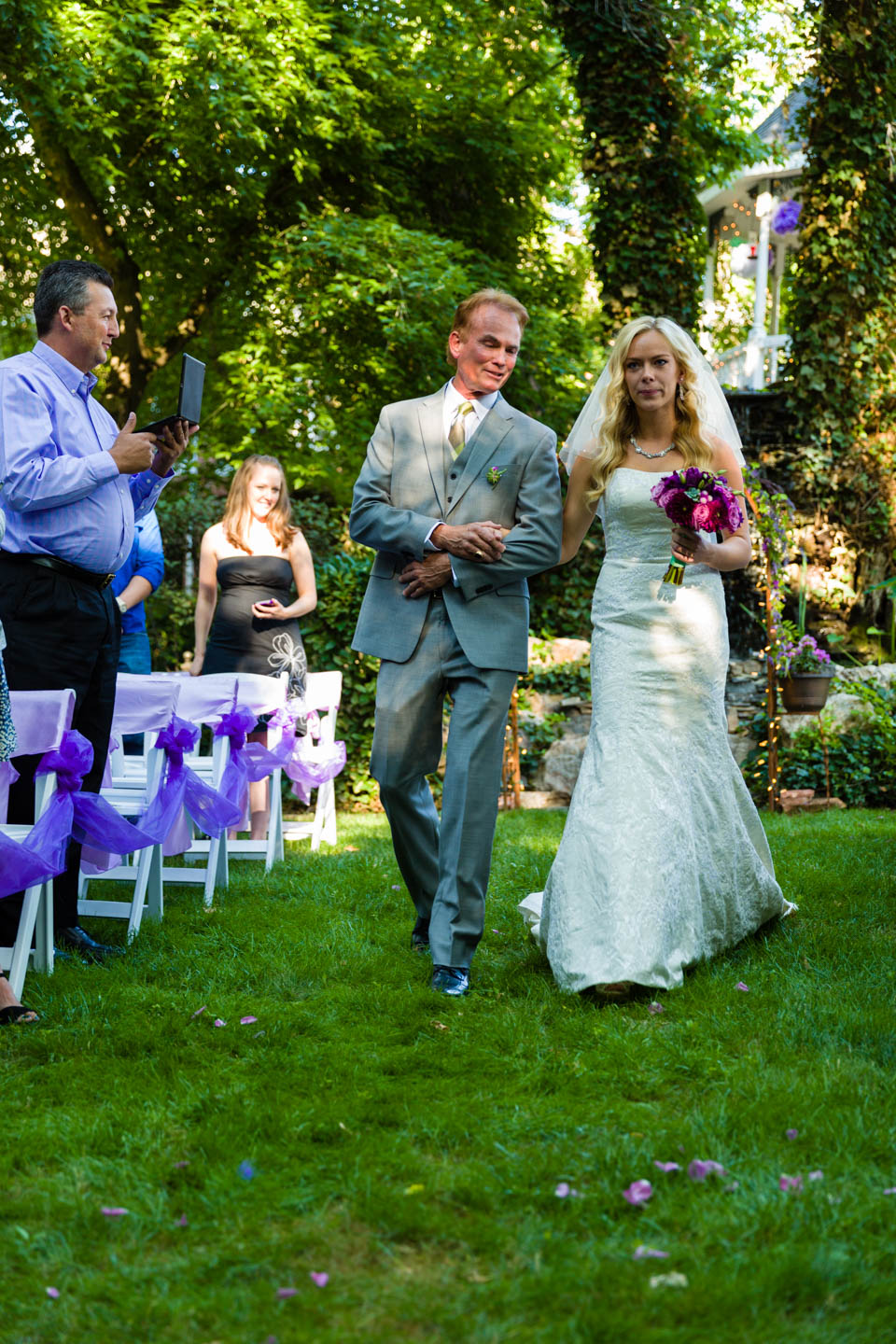 Father of the bride walks her down the aisle