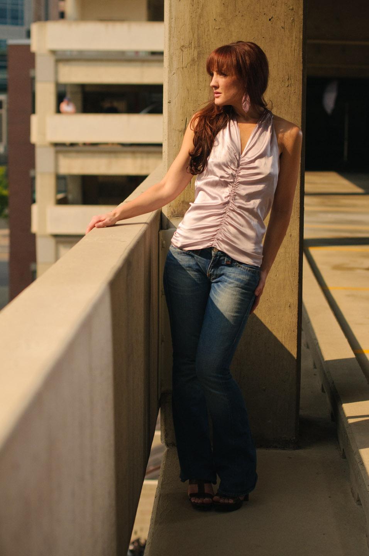 Female model in a parking garage.