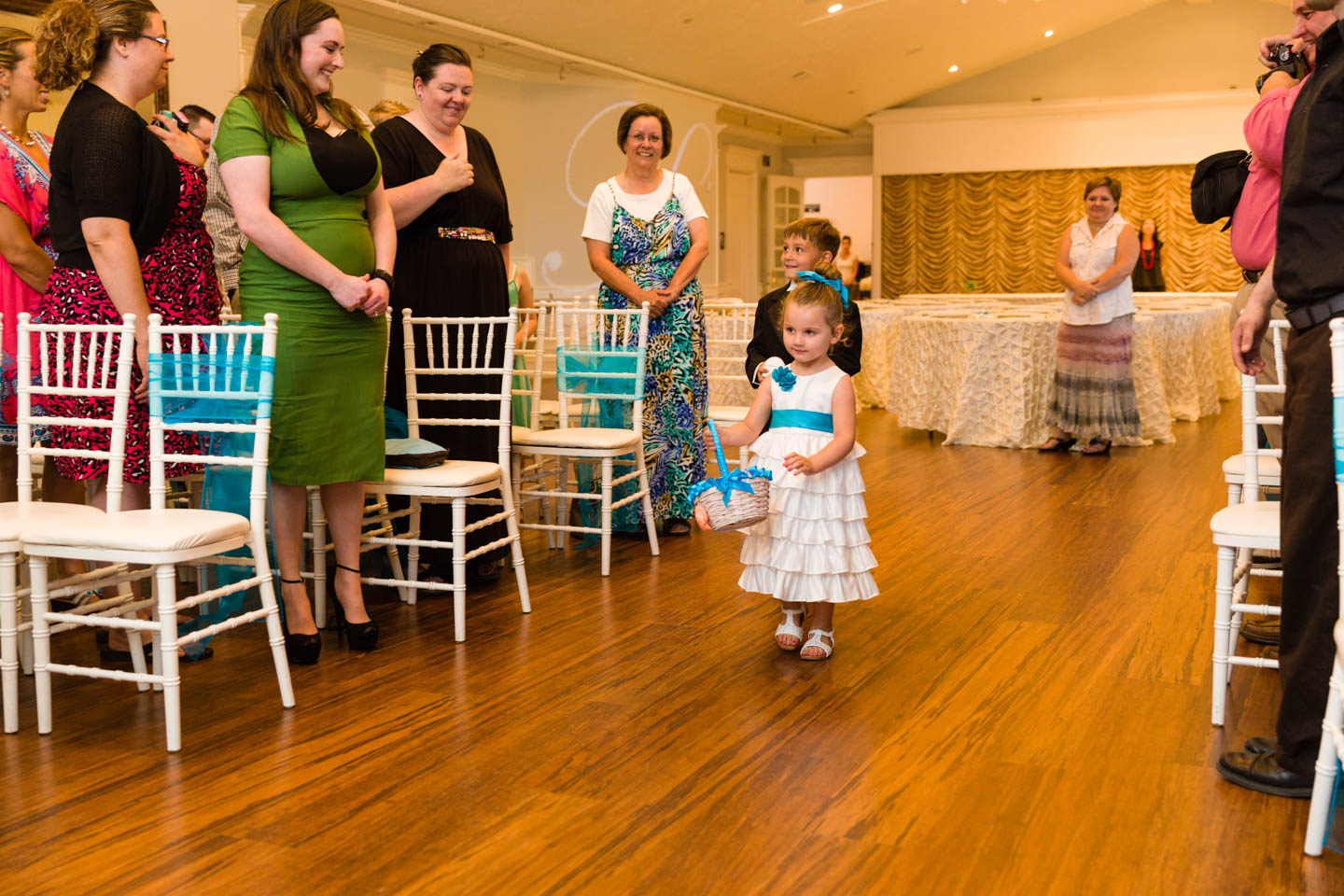 Flower girl throwing absolutely no flowers