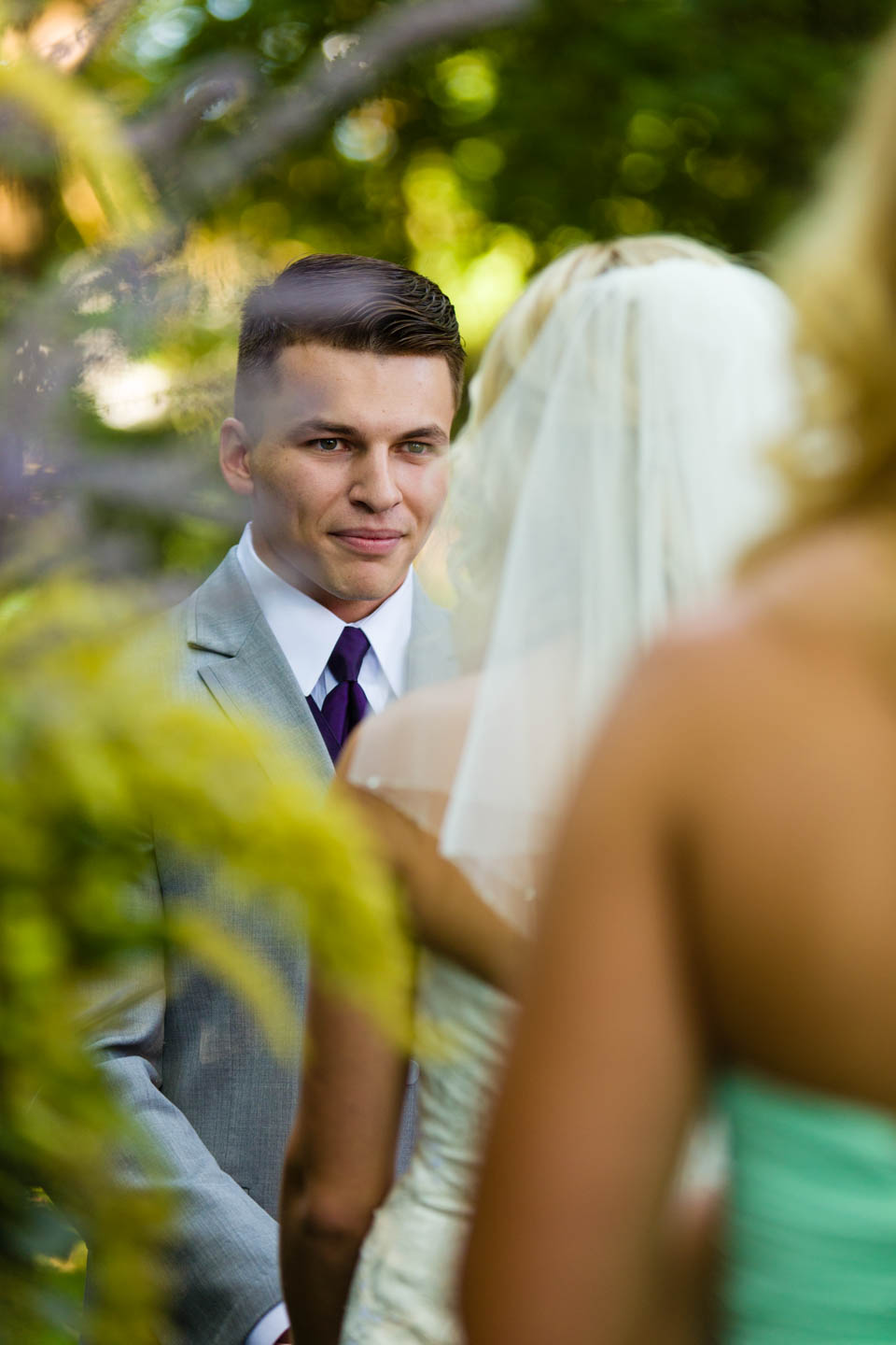 Groom looks at the bride