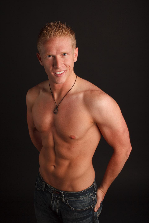 Male model shirtless portraits in studio