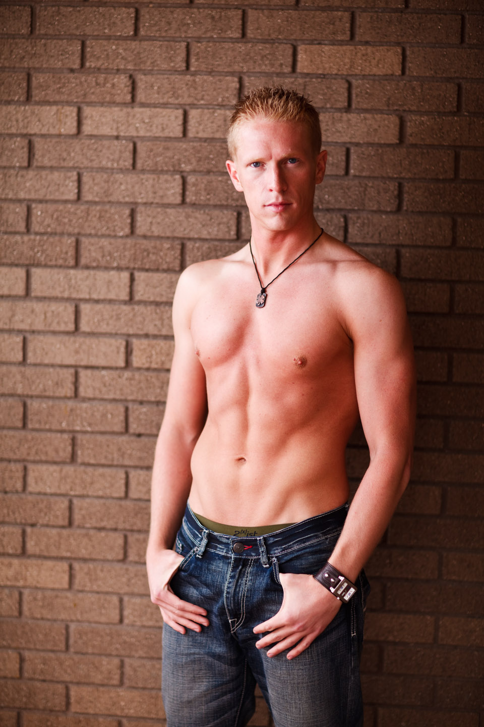 Going shirtless with a brick wall