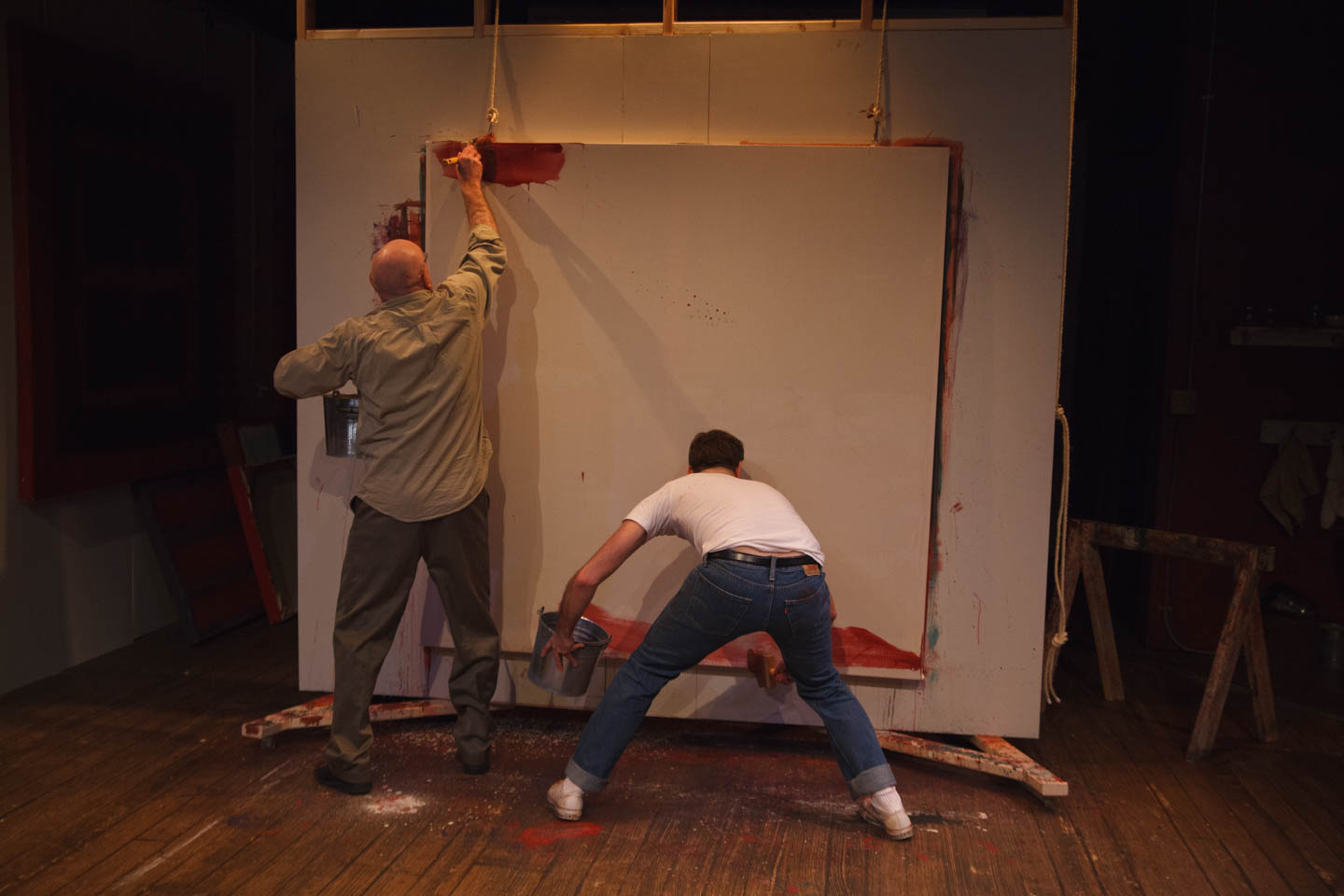 Painters paint for the Four Seasons in the play RED