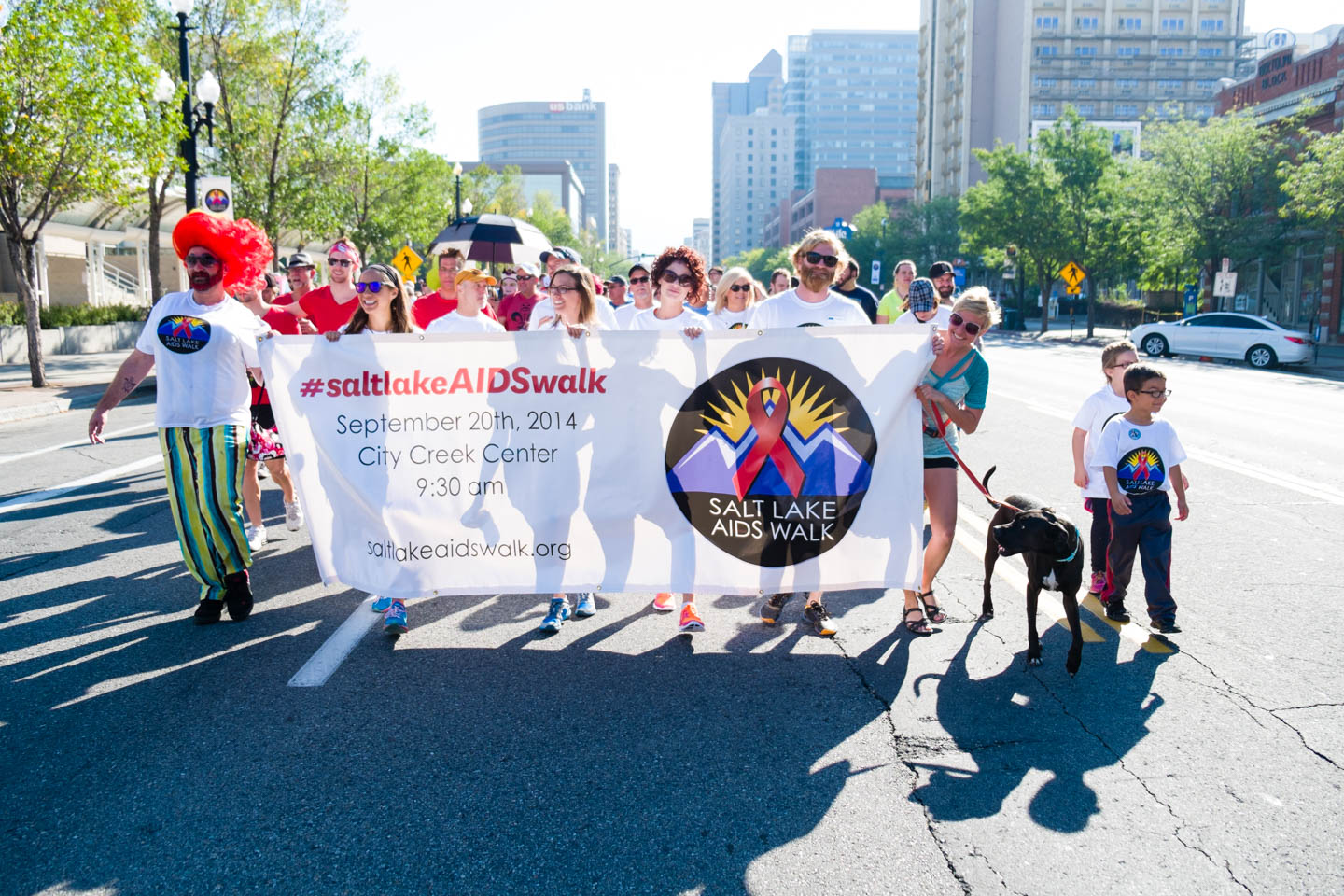 Walkers Carry the AIDS Walk Banner