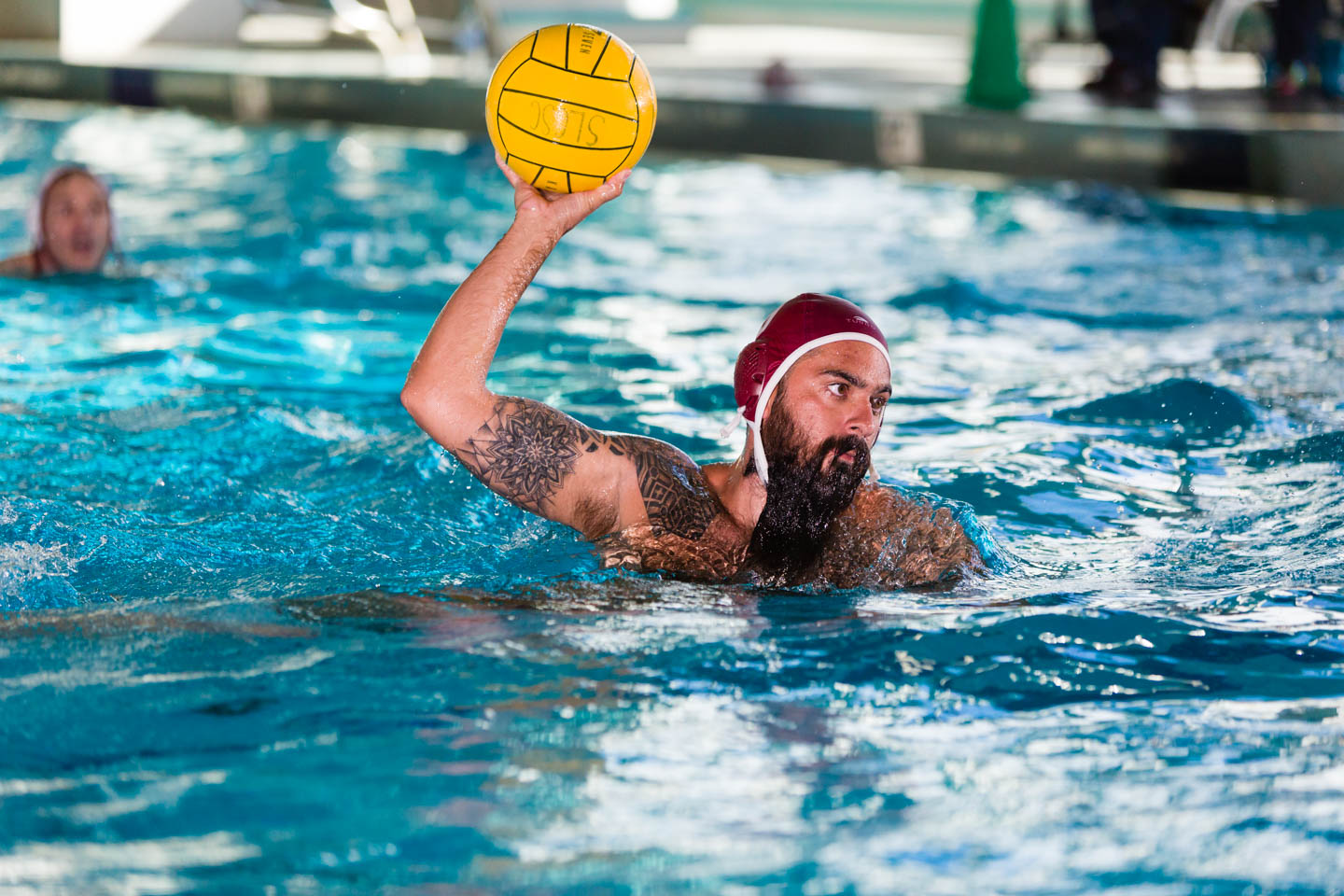 Farook takes a shot on goal during a water polo game