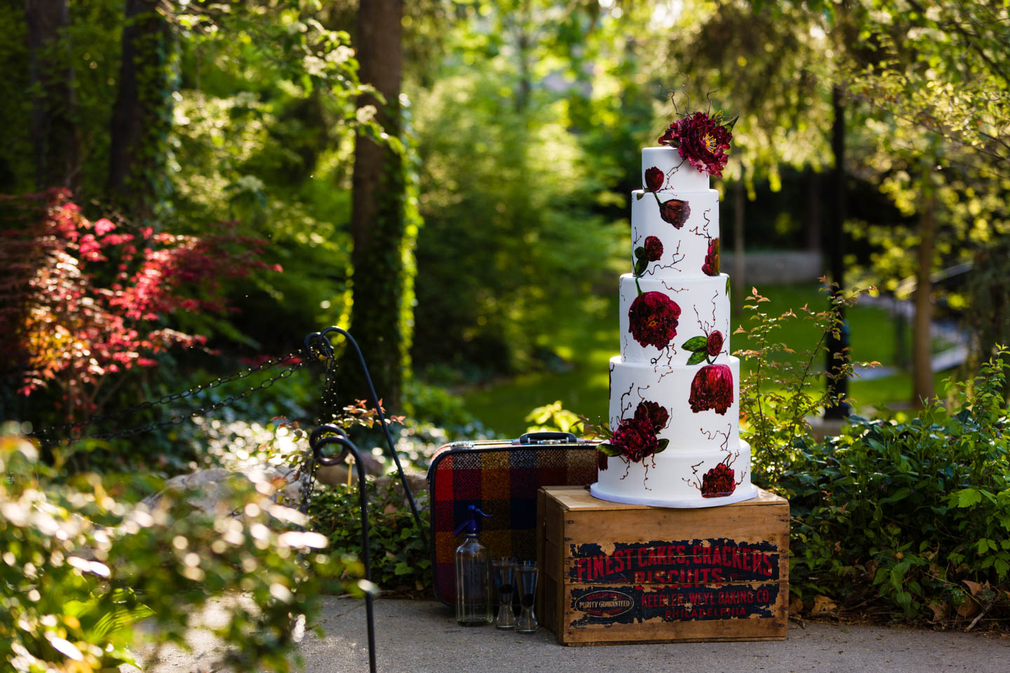 Very tall 5-layer wedding cake by Le Croissant Catering