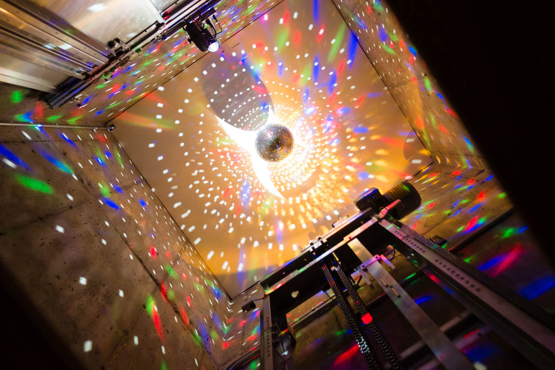 Disco Ball in an Elevator Shaft