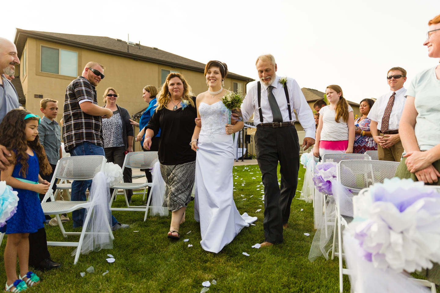 Bride walks down the aisle with parents