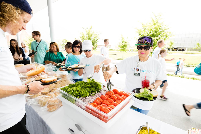 Volunteers enjoy a buffet lunch