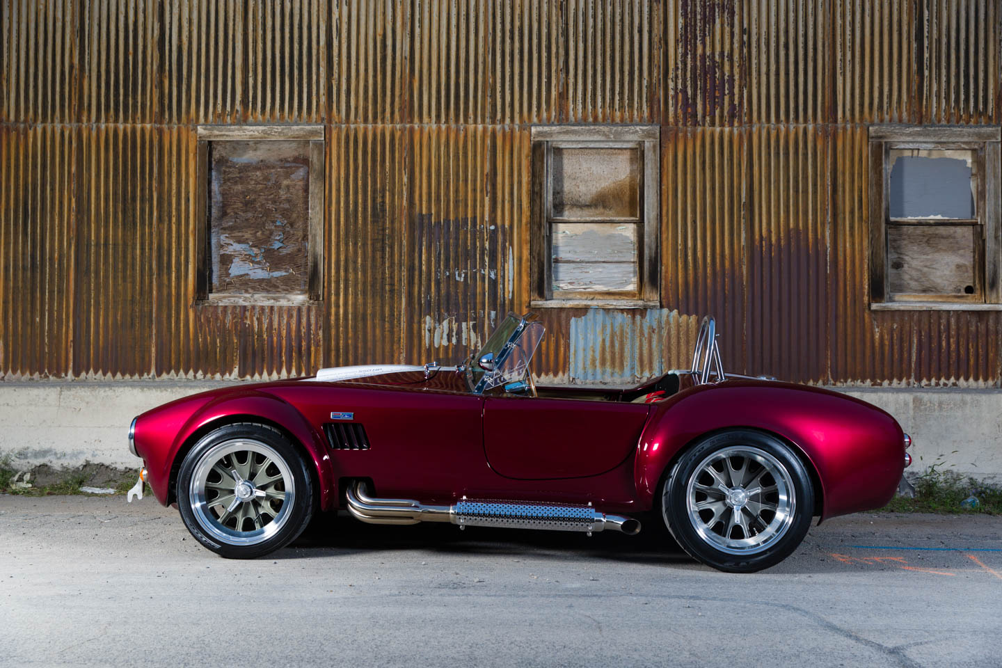 Side view of the candy red Shelby Cobra replica