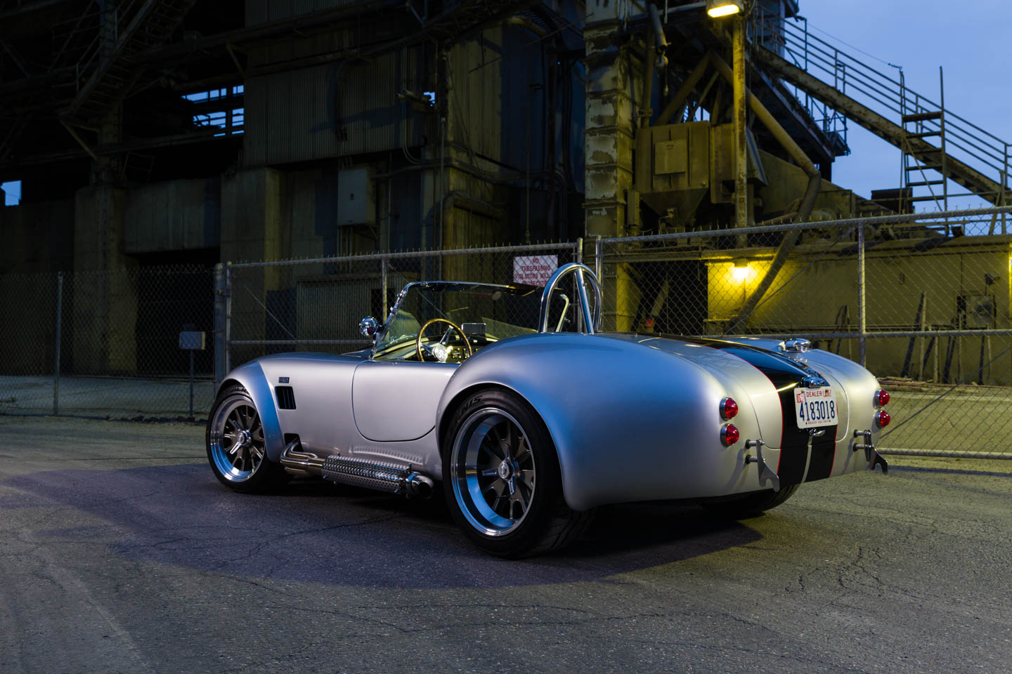 Silver Shelby Cobra by a factory