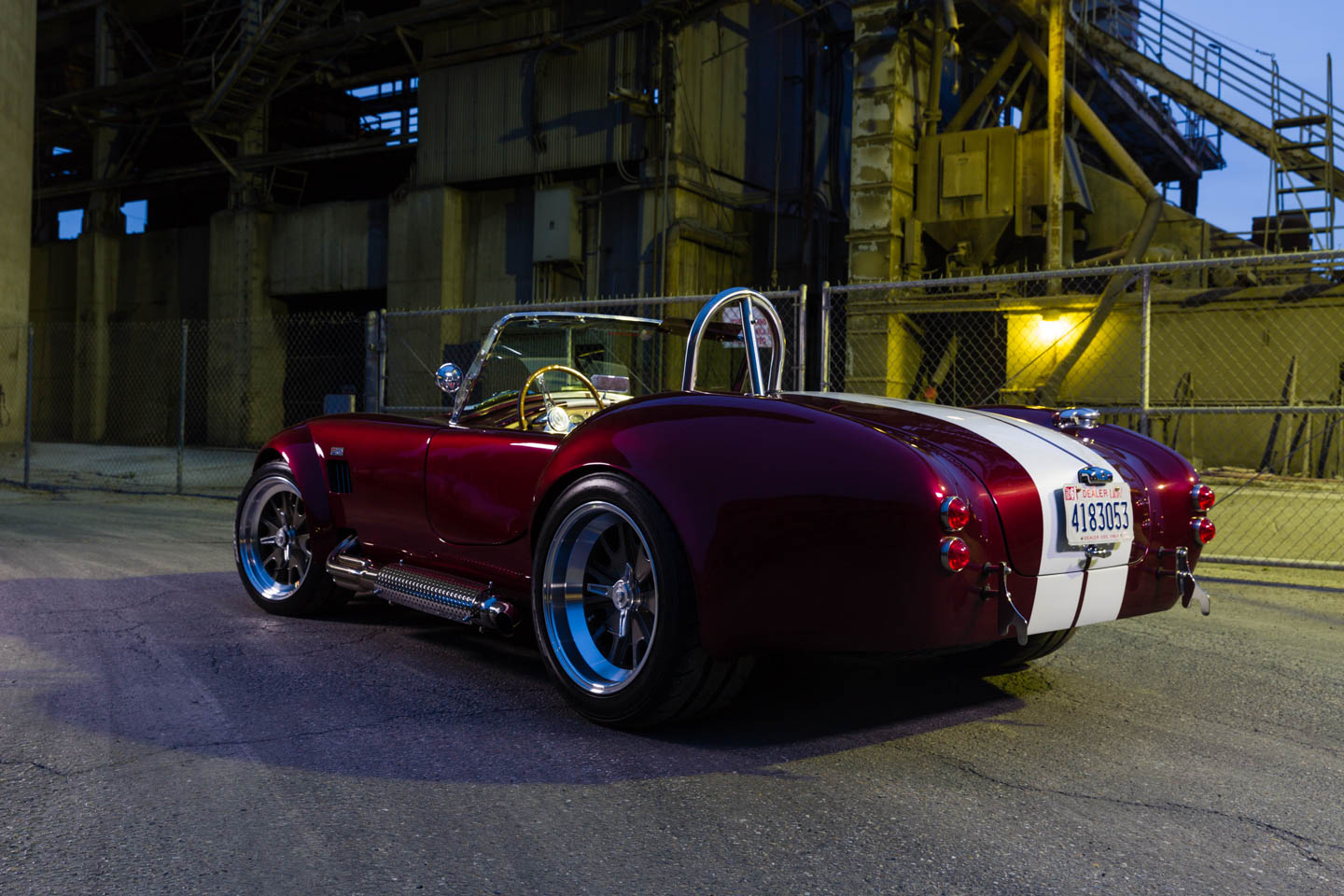 Candy Red Shelby Cobra outside a factory