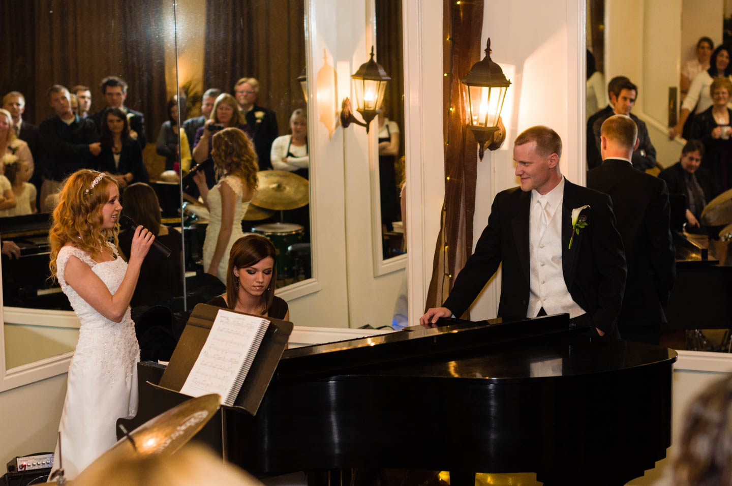 Bride serenades the groom at the grand piano