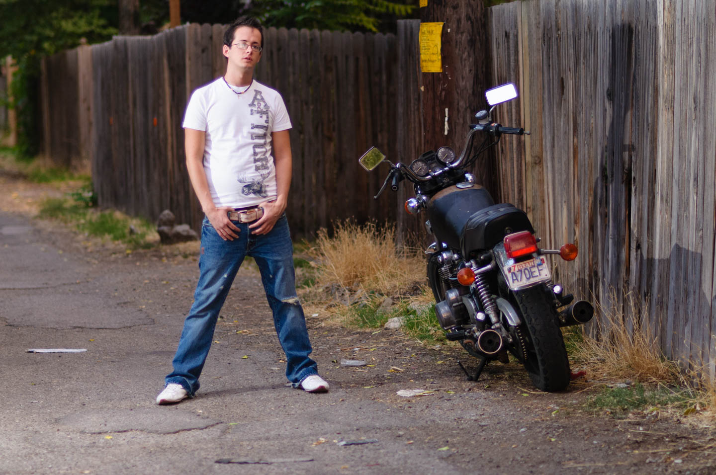 Bobbie poses next to a motorcycle