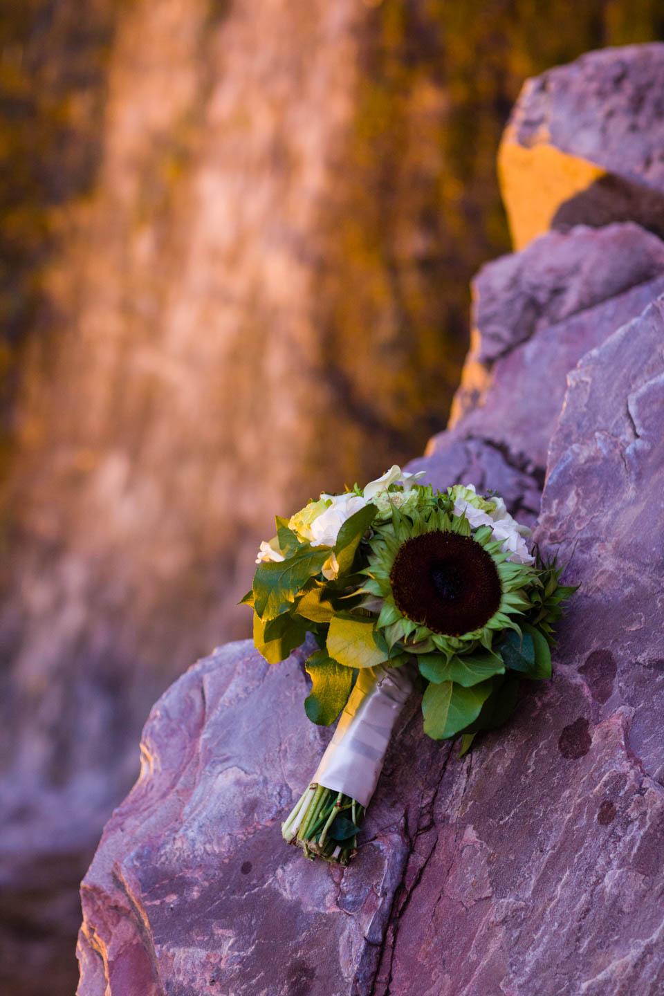 Wedding bouquet by the waterfall