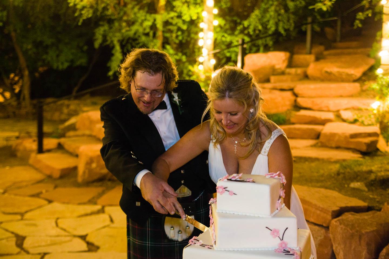 Bride and groom cut the wedding cake