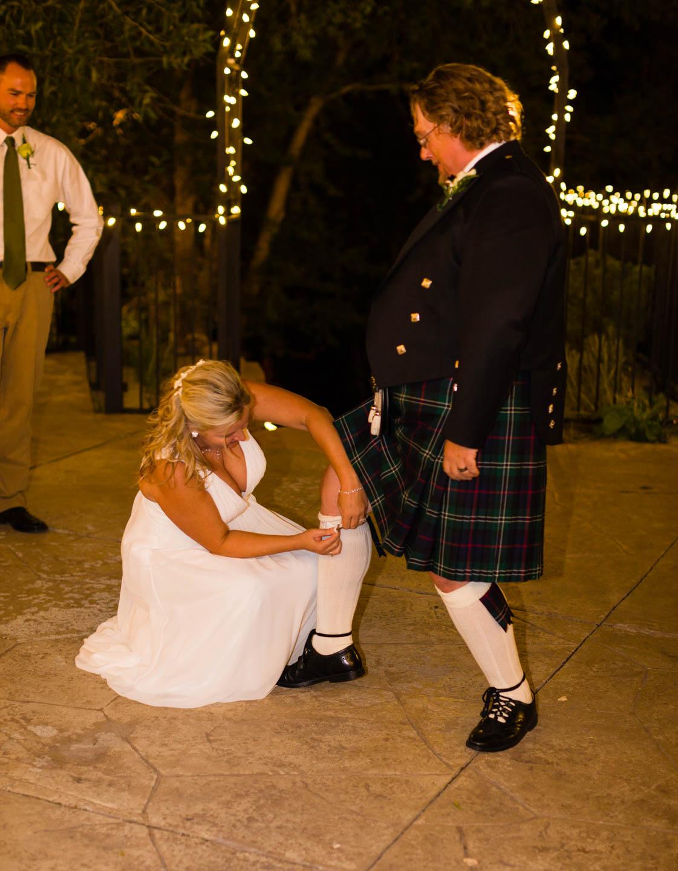 Bride pulls the groom's garter belt