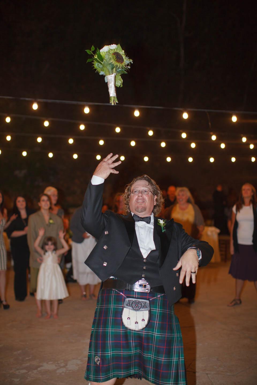 Groom tosses the wedding bouquet