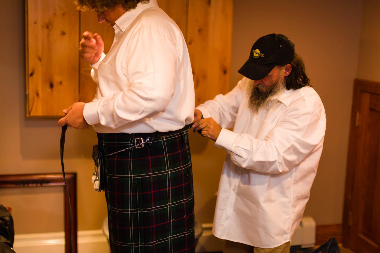 Groom wears a Scottish kilt for the wedding